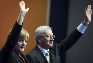 New European Commission President Jean-Claude Juncker with his principle sponsor, German Chancellor Angela Merkel.  - uk.news.yahoo.com